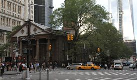 Morning commute in Manhattan. Early morning commuters walk, taxi and drive themselves to work Royalty Free Stock Photo