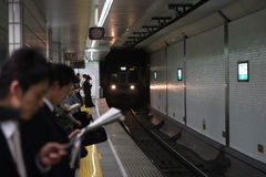 Morning commute on the subway. Tokyo subway station as riders prepare for the daily commute Stock Image