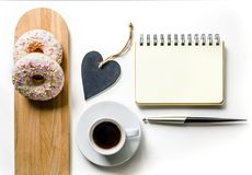 Morning composition with coffee and donuts. To-do list. Office table desk. Home office workplace. Royalty Free Stock Image