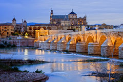Morning in Cordoba. Roman Bridge on Guadalquivir river and Mezquita Cathedral (Great Mosque) at dawn in the city of Cordoba, Andalusia, Spain royalty free stock photos