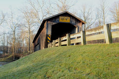 Morning covered bridge on rural river and woods Stock Images