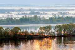 The Morning Covered with Fog. Dawn on the Volga river. Morning fog covers the coast Royalty Free Stock Photography