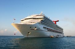 Morning Cruise Liner. The cruise liner filled with early morning light in Belize Stock Photo