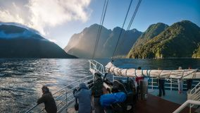 Morning Cruise ride at Milford Sound in New Zealand. Milford Sound, New Zealand -December 22, 2017: People enjoying a Cruise ride early in the morning at Milford Stock Photo