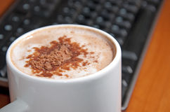 Morning cup of cappuccino with chocolate chips Royalty Free Stock Photography