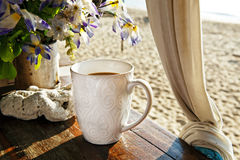 Morning cup of coffee on the beach Royalty Free Stock Photos