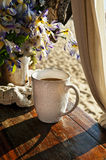 Morning cup of coffee on the beach Stock Images