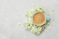 Morning Cup of coffee and a beautiful hydrangea flowers on light background, top view. Cozy Breakfast. Flat lay style. Royalty Free Stock Photography