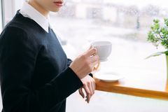 Morning cup coffee caffeine dependence woman hold. Morning cup of coffee. caffeine dependence. woman holding a cup of hot invigorating drink Royalty Free Stock Images