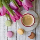 Morning cup of coffee, cake macaron stock photos