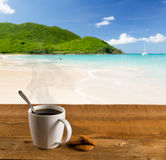 Morning cup of coffee on caribbean beach Stock Photo