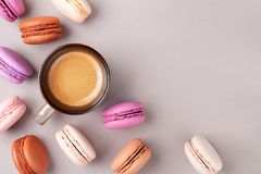 Morning cup of coffee and colorful cake macaron or macaroon top view. Flat lay stock images