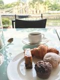 Morning cup of coffee with selection of cakes. Royalty Free Stock Photo