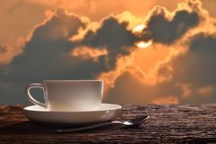 Cup of coffee. Morning cup of coffee or tea with sunrise background Royalty Free Stock Photo