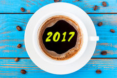 Morning cup of coffee top view with inscription 2017. Eve, Christmas and New year concept Stock Images
