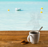 Morning cup of coffee by warm caribbean sea Stock Photo
