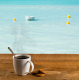 Morning cup of coffee by warm caribbean sea Stock Photos