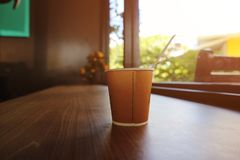 In the morning with a cup of coffee on the wood table Stock Photography