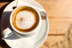Morning cup of coffee, on the wooden table Royalty Free Stock Photos