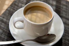 Morning cup of espresso in the morning sun Royalty Free Stock Photo
