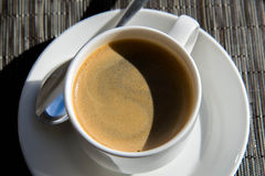 Morning cup of espresso in the morning sun Stock Photo