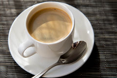 Morning cup of espresso in the morning sun Stock Photography
