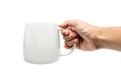 Morning cup. A hand holding a white cup Stock Photo