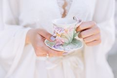 Morning cup of tea in female hands royalty free stock photography