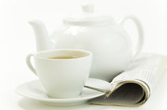 Morning cup of tea and press on white Royalty Free Stock Photos