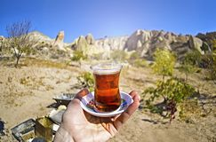 Morning cup of tea with Red valley and rocks background view stock photo