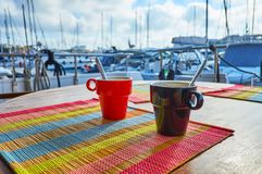 Morning tea on yacht, Valletta, Malta. The morning cup of tea with a view on Valletta marina with numerous sailing yachts on background, Malta Stock Photos