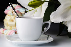 Morning cup of tea, white lily, colored marshmallow Royalty Free Stock Photo