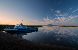 Morning on the dark blue lake. Landscape with boat, near Ostashkov, Seliger Lake, Russian Royalty Free Stock Photo
