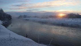 Morning dawn on the river in a strong frost. Evaporation from water in bitter cold. stock footage