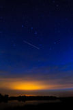 Morning dawn on  starry background sky reflected in the water o Royalty Free Stock Images