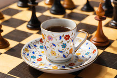Morning with the day planning. Strategy concept with a cup of coffee and chessboard. Stock Photography