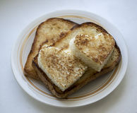 Morning declaration of love. Toast on a plate in the form of heart Royalty Free Stock Photos