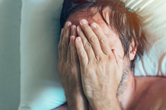 Morning depression and midlife crisis with man in bed Stock Photos
