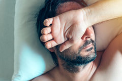 Morning depression and midlife crisis with man in bed Royalty Free Stock Photography