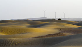 Morning in Desert and Windmills Stock Photos