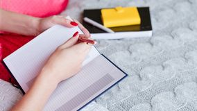 Morning diary bed office woman making notes stock image