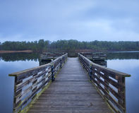 Morning dock. Handicapped fishing dock at Upchurch Lake in the early morning royalty free stock images