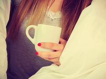Woman holding cup of hot drink, no face stock photography