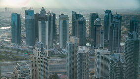Morning in Dubai Marina with towers and traffic on road from skyscrapper, Dubai, UAE timelapse 4K. Morning after Sunrise in Dubai Marina with towers and traffic stock video