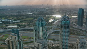 Morning in Dubai Marina with towers and traffic on road from skyscrapper, Dubai, UAE timelapse 4K. Morning after Sunrise in Dubai Marina with towers and traffic stock video footage