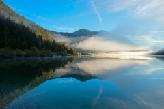Morning dust at idyllic lake plansee in autumn Stock Photo