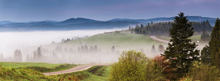 Morning empty asphalt road panorama. Beautiful Summer Mountain R. Oad. Mountain range serpentine. Beautiful misty morning traveling background Royalty Free Stock Photography