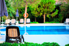 Morning empty pool at the hotel and sun loungers Royalty Free Stock Photo