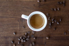 Morning Espresso. Freshly brewed espresso surrounded by coffee beans Stock Photography