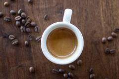 Morning Espresso. Freshly brewed espresso surrounded by coffee beans Stock Image
